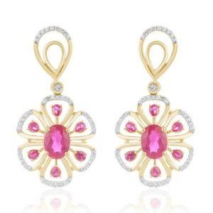 18 k gold 3.9 ctw diamond earrings.